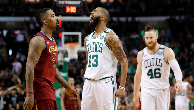 Boston Celtics forward Marcus Morris (13) reacts after a score against the Cleveland Cavaliers during the second quarter in game one of the Eastern conference finals of the 2018 NBA Playoffs at TD Garden.