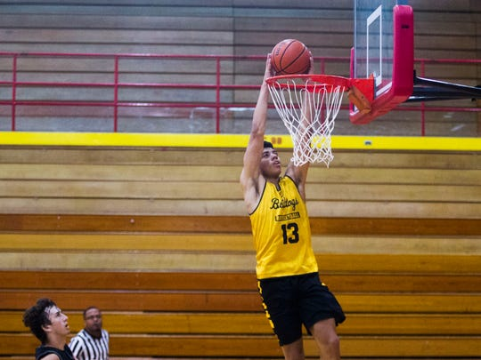 Bettendorf point guard D.J. Carton dunks during a basketball game against Rock Island in the Justin Sharp Memorial Shootout at Rock Island High School on Friday, June 22, 2018 in Rock Island, Illinois. Carton is entering his senior year at Bettendorf.