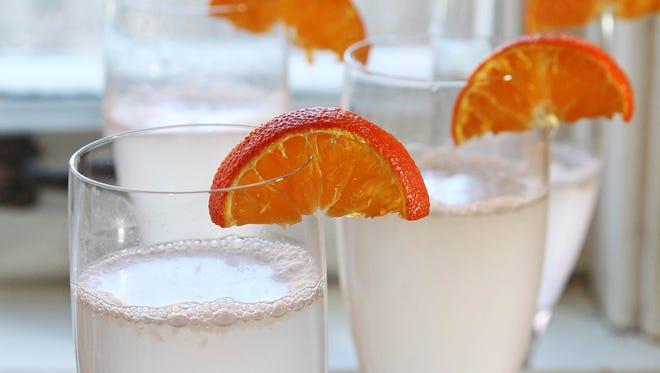 Grapefruit mimosas are garnished with kumquats or oranges.