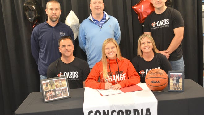 Sault High senior Lilly Alaspa, front row center, has committed to attend and play basketball at Concordia University in Ann Arbor. Pictured front row, left and right are Lilly's parents Ryan and Cindy Alaspa, and back row, from left to right, Sault girls basketball assistant coach Jim Bennin, Sault girls basketball head coach Pat Bennin, and Ryley Alaspa.