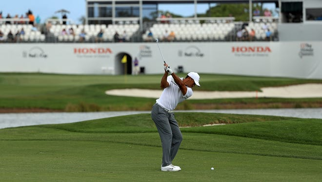 Tiger Woods plays during a pro-am for the Honda Classic Wednesday in Palm Beach Gardens. Since turning professional in late 1996, Woods has missed just 17 cuts in 316 starts on the PGA Tour. He has never missed the cut in consecutive weeks, but that is in jeopardy this week.