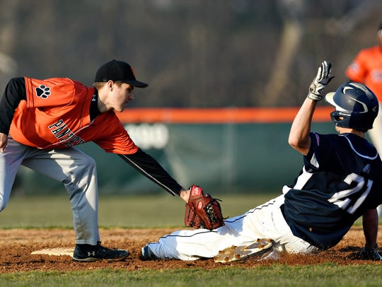 Central York's Ben Reed, left, tags out West York's