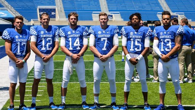 Kentucky's quarterbacks from left to right are Walker Wood (17),  Gunnar Hoak (12), Luke Wright (14), Drew Barker (7), Stephen Johnson (15), and Danny Clark (13).  July 30, 2017