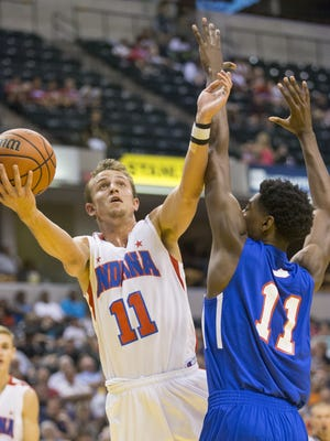 Matt Holba of Guerin Catholic High School, clears a path for this shot against Kentucky's Aric Holman, first half of Indiana vs. Kentucky All-Stars, Bankers Life Fieldhouse, Indianapolis, Saturday, June 13, 2015.