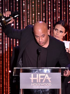 "Vin Diesel (L) and Jordana Brewster accept the Hollywood Blockbuster Award for ""Furious 7"" onstage during the 19th Annual Hollywood Film Awards."