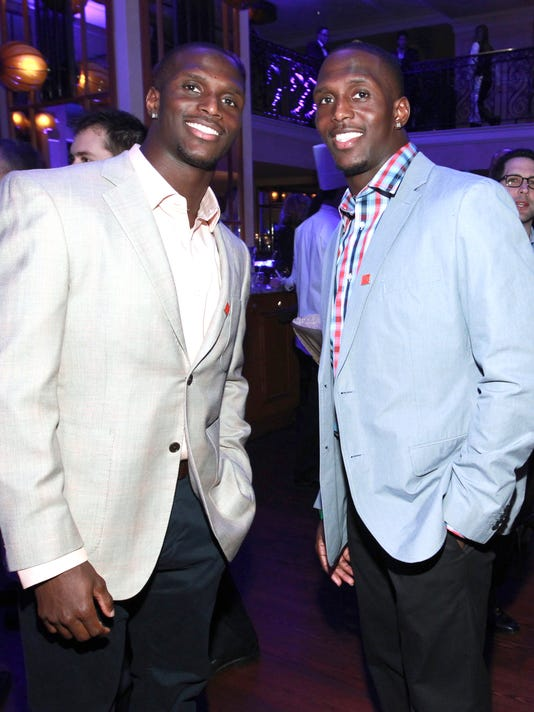 FILE - In this Jan. 31, 2013, file photo, NFL football players Jason McCourty, left, and Devin McCourty pose at the VIP Reception hosted by the NFLPA in New Orleans. New Patriots cornerback Jason McCourty has trouble settling on one thing that excites him most about finally playing alongside twin brother Devin next season. He's looking forward to everything — from sitting in team meetings to sweating through offseason workouts. That's because Jason wants to soak up every moment of a dream they've shared since he was drafted by the Tennessee Titans in 2009 and Devin went to the Patriots in 2010. (Photo by Dario Cantatore/Invision for NFLPA/AP Images, via AP, File)