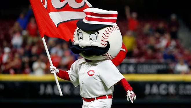 Mr. Redlegs waves the Reds flag after the ninth inning of the MLB National League game between the Cincinnati Reds and the Miami Marlins at Great American Ball Park in downtown Cincinnati on Friday, May 4, 2018. Raisel Iglesias tallies a save as the Reds win 4-1.