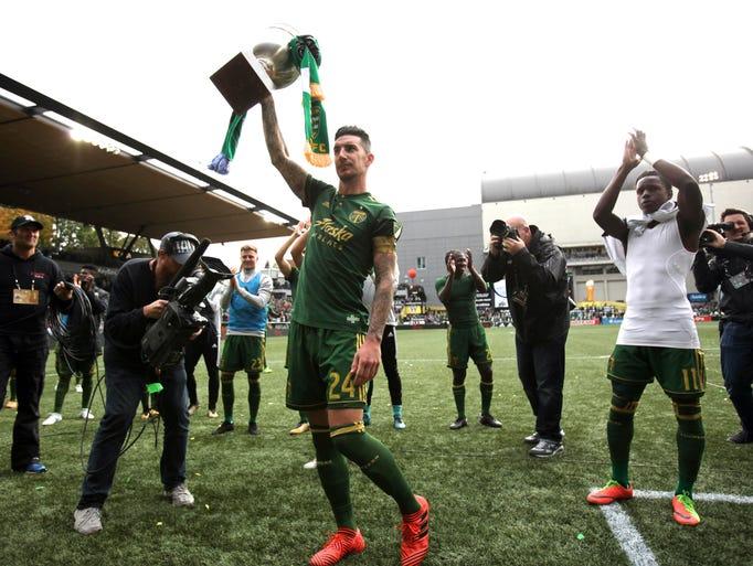 Portland Timbers defender Liam Ridgewell (24) raises