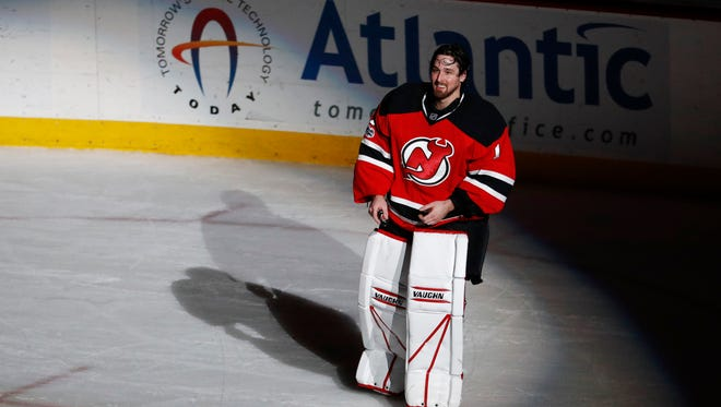 New Jersey Devils goalie Keith Kinkaid (1) takes a curtain call after a 1-0 overtime victory over the Philadelphia Flyers during an NHL hockey game, Tuesday, April 4, 2017, in Newark, N.J. (AP Photo/Julio Cortez)