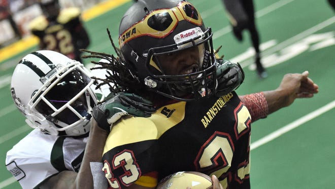 Iowa's Javicz Jones (23) is run down by Green Bay's Ike Williams during the first half of the Indoor Football League game at Wells Fargo Arena on Saturday.