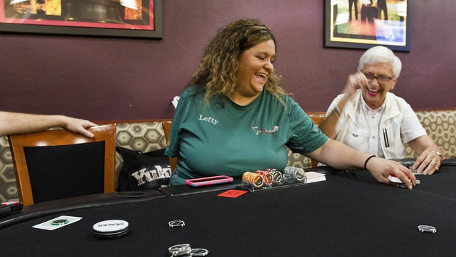 "Heather ""Lefty"" Schneck, 36, manages a poker game at Nemo's at HeadPinz in Cape Coral. Schneck lost her arm in a car crash in 2008. The driver was drinking. She's an avid poker player who became a dealer."