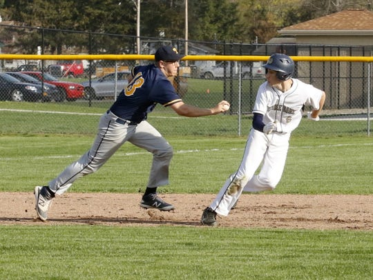 Tioga's Damon Rockwell tags out Notre Dame's Gary Raupers