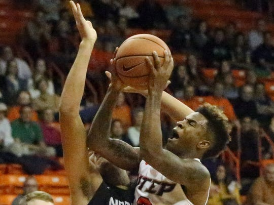 UTEP freshman guard Evan Gilyard, 3, drives for a layup against North Texas Thursday night in the Don Haskins Center.