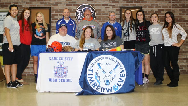 Abby Joseph was flanked by her parents Gary and Dorinda, and surrounded by teammates and coaches during Wednesday's signing ceremony.