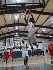 Grace Christian's Elijah Hampton (35) skies for a dunk against Glenmora Friday, Jan. 26, 2018. The Warriors are hoping to break through and earn a state title with a loaded group of seniors.