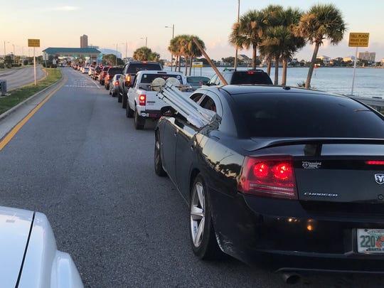 Traffic backs up at the Bob Sikes Toll Bridge early