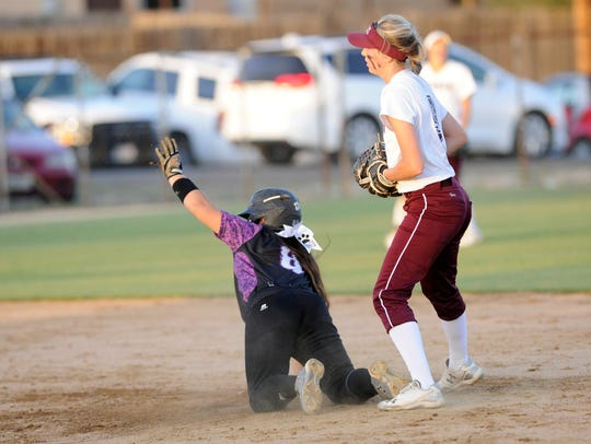 Wylie's Halle Arbilera (8) asks for time after sliding safely into second base during the Lady Bulldogs' 4-3 loss to Vernon in Game 2 of the bi-district playoffs.