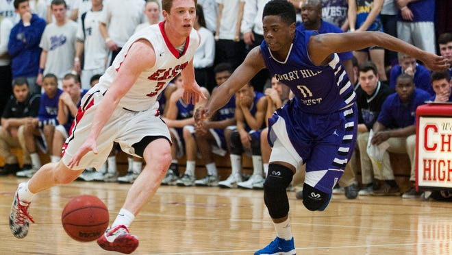 Cherry Hill East's Jake Silpe (3) and Cherry Hill West's Elijiah Bey (0) battle for the ball in a Group 4 tournament game.
