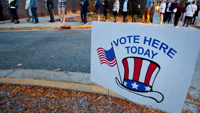 In a Nov. 8, 2016, file photo, voters line up to vote at Westminster Presbyterian Church in Grand Rapids, Mich.