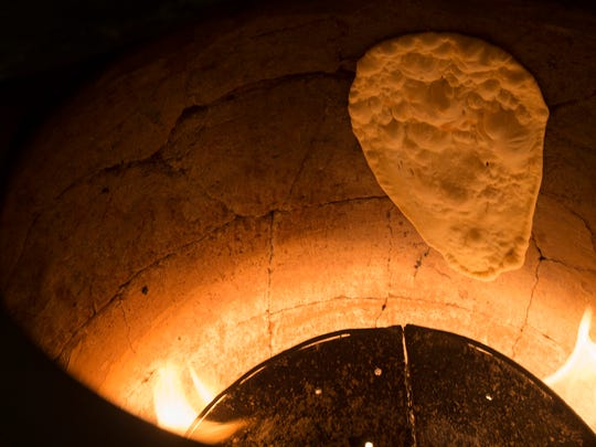 Naan bakes inside a tandoor oven at Shloka, an Indian restaurant in Freehold Borough.