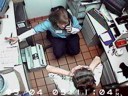 In a frame taken from a McDonald's surveillance video that is part of the court record, Mount Washington McDonald's employee