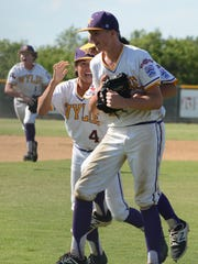 Wylie Junior League All-Stars reliever Reed Hughes is mobbed after the recording the final out of a 3-1 win over Alice American to secure the Texas West state championship Tuesday at Kirby Park.
