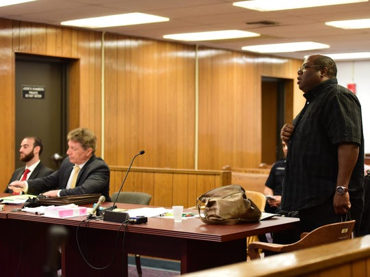 At right, Elie Jones dismissed with prejudice his criminal complaint against Teaneck clerk Issa Abbasi, at left, before Judge Roy McGeady Thursday morning May 25, 2017.