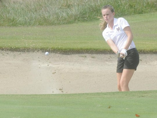 Mountain Home's Kenzie Collins hits a shot out of the sand on the 18th hole Tuesday at Big Creek Golf & Country Club during the Class 6A State girls golf tournament.