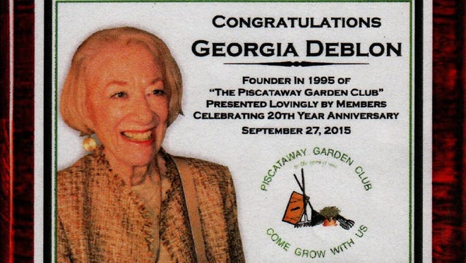 The highlight of this gathering was that guests, past and present members celebrated the club's 20th anniversary, and recognized Georgia DeBlon, the founder of the Piscataway Garden Club.