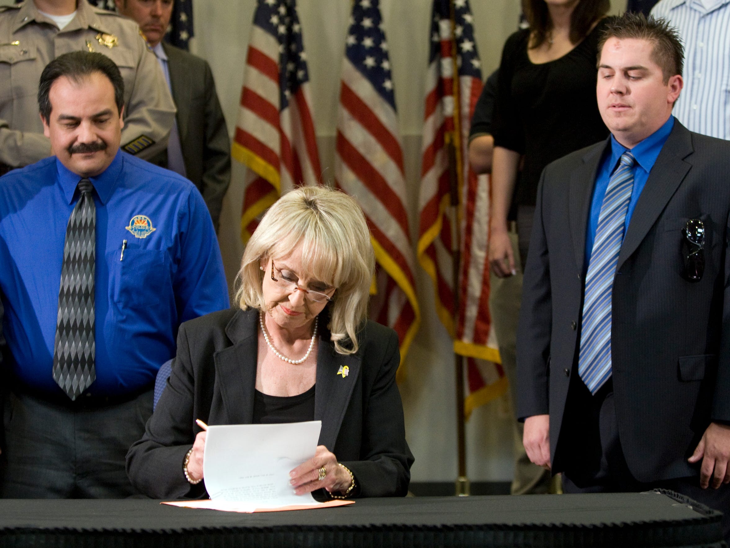 Gov. Jan Brewer  signs SB 1070 into law at ADOT offices