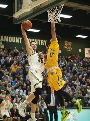 UVM forward Drew Urquhart (25) leaps for a layup during the men's basketball game between the Siena Saints and the Vermont Catamounts at Patrick Gym last month.