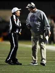 """In this archive photograph, Wylie High football coach Hugh Sandifer """"speaks"""" with an official during the state semifinal game in 2016, which Wylie won to earn a spot in the state championship for Class 4A. Reporter-News education reporter Timothy Chipp knows what the official feel like."""