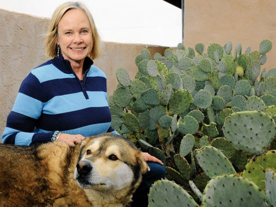 Cynthia Risner shows a stand of cactus, planted as a tribute to her brother John Risner.