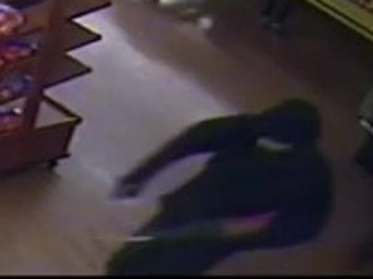 Surveillance video captured a quick glimpse of a person carrying a tool believed to be used to cut a hole through Sack 'N Save's roof and safe on March 26, 2018.