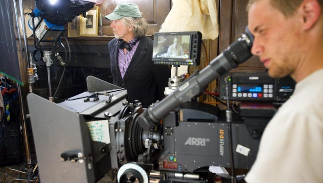 """Director Jay Craven looks on as cast and crew prepare to shoot a scene during filming of """"Northern Borders"""", based on the book by Howard Frank Mosher, at the Whetstone Inn in Marlboro in 2012."""