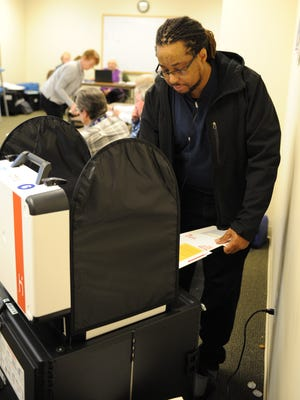 Novi voter Rodney English casts his vote in the city election on Tuesday.