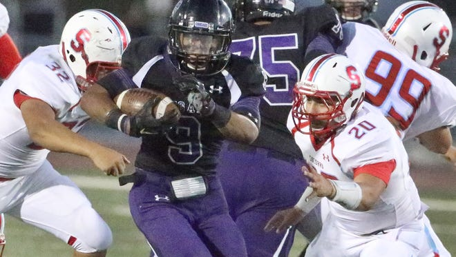 Franklin running back Michael Faimalo, 9, breaks through the Socorro defensive line and on to a touchdown Thursday night at Franklin.