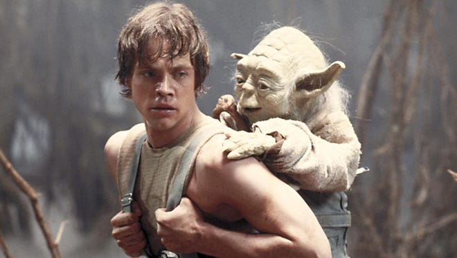 """Mark Hamill as Luke Skywalker and the character Yoda appear in this scene from 1980's  Star Wars Episode V: The Empire Strikes Back."""""""