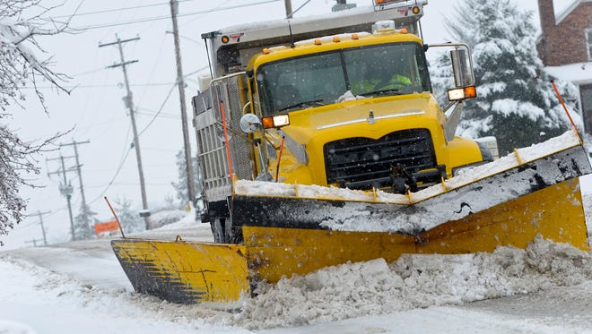 A PennDot snow plow clears the east bound lane of East Prospect Road in York Township, Monday February 3, 2014.  York Dispatch File Photo