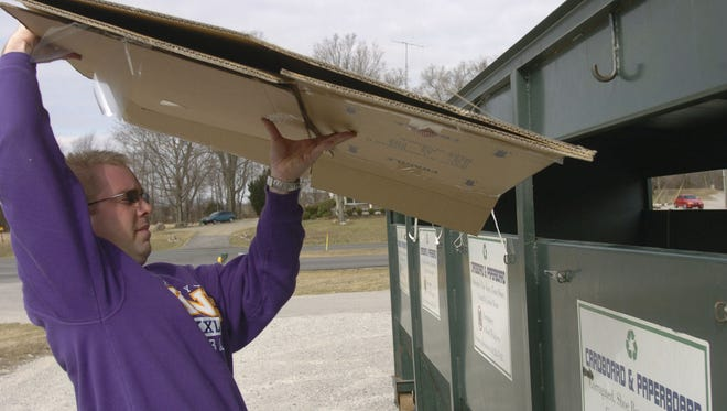 Jim Hughley dropping off cardboard at the Clark Co. Solid Waste Management District in Charlestown, Ind.