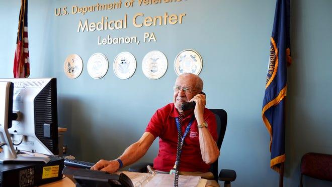 USAF Veteran Bob Boyer, recipient of the 2015 Nurses Organization of Veterans Affairs Veteran Award, mans the information desk at the Lebanon Veterans Administration Medical Center as an ambassador volunteer.