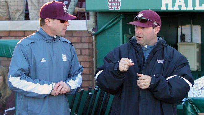 Mississippi State head coach John Cohen and pitching coach Butch Thompson talking at Dudy Noble Field in 2015. Thompson, now the Auburn head coach, worked at MSU under Cohen from 2008-15.
