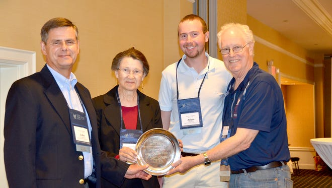From left, are Land Conservancy of Adams County President John Kiehl, Vice President Norma Calhoun, Conservation Coordinator Adam Boyer, and Civil War Trust President Jim Lighthizer with the Brian C. Pohanka award, presented at the Civil War Trust conference in Gettysburg on June 2.