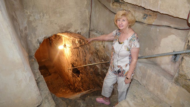 Sandy Jones, chairperson of The Friends of Light's Fort Committee of the Historic Preservation Trust of Lebanon County, points the way to the fort's cellar where a fresh water spring channels through it.