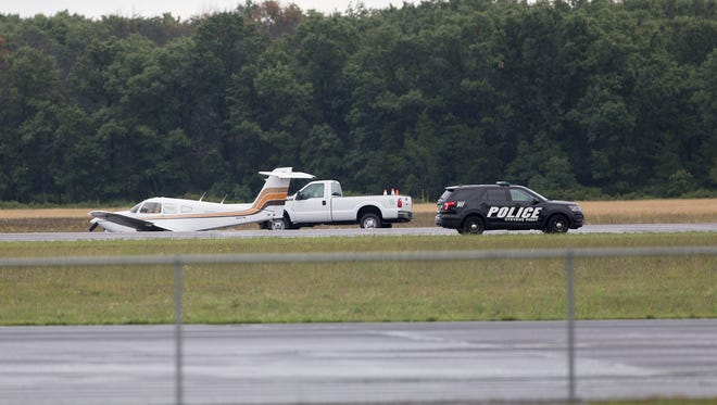 An airplane on the runway at the Portage County Regional Airport in Stevens Point after landing without a landing gear, Thursday, July 28, 2016.