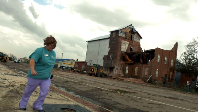 A medical worker runs down Main Street by the historic mill in Windsor after a deadly tornado tore through downtown on May 22, 2008. More than eight years later, Fort Collins-based Blue Ocean Enterprises plans to redevelop the mill into a distillery concept or brewpub.
