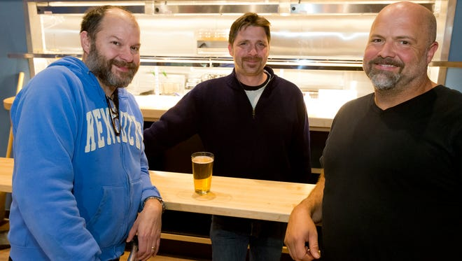Atlas owners, from left, Pete Browning, Todd Parlato, and Jon Wagner have joined together to created the restaurant, bowling alley and night spot in Trumansburg.