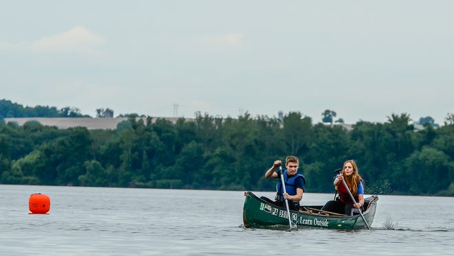 John Whitcomb, 15, and Abby Hebenton, 17, of Fairfild High School, paddle their way to the championship trophy by winning the 2nd Annual Chesapeake Bay Foundation PA Student Leadership Council Canoe Classic, Saturday, May 27, 2017, on the Susquehanna River at Long Level. John A. Pavoncello photo