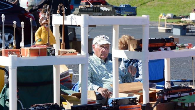 "Leonard Lenzen of Swansea, Ma. sits at his model train display with his wife Veronica during a ""World's Greatest Train Meet"" pre-show in the Wyndham Garden Hotel parking lot Wednesday, Oct. 18, 2017. A handful of pre-shows took place in York before the weekend event. The show starts Thursday for Train Collecters Association members only. Friday and Saturday the public is invited to the ticketed event. Show hours are 9 a.m. to 6:30 p.m. Friday and 9 a.m. to 4 p.m on Saturday. Bill Kalina photo"