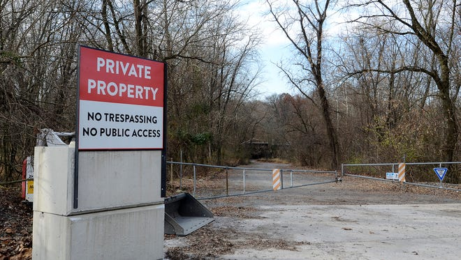 "Concrete barriers and a large ""Private Property"" sign has been erected at the entrance of the wetlands trail along Wago Road in York Haven. Talen Energy has closed Fisherman's Park and other public access areas around the Brunner's Island power plant, Thursday, Nov. 30, 2017. John A. Pavoncello photo"